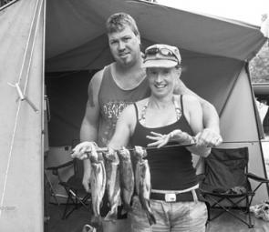 Dean Lacey and Maryanne Mitchell, with a new year's catch of fresh trout from the Kiewa River at Tawonga.